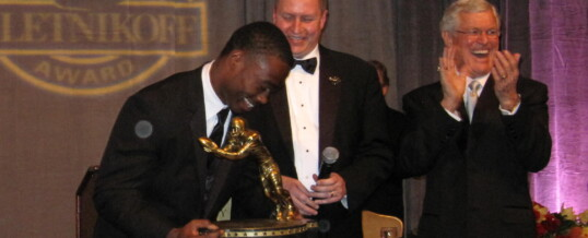 Foundation Chairman Ritchie Pickron presents 2013 Biletnikoff Award winner Brandin Cooks the most beautiful (and heaviest) trophy in college sports, while keynoter Dick Vermeil assists.